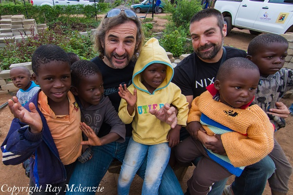 Neale Bayly and Anthony Carrino South with orphans from the African White River Area