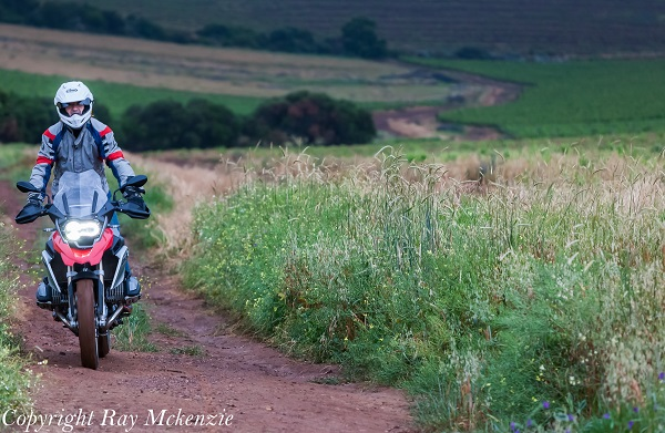 Neale Bayly riding the BMW R1200GS off road in the rain with street tires