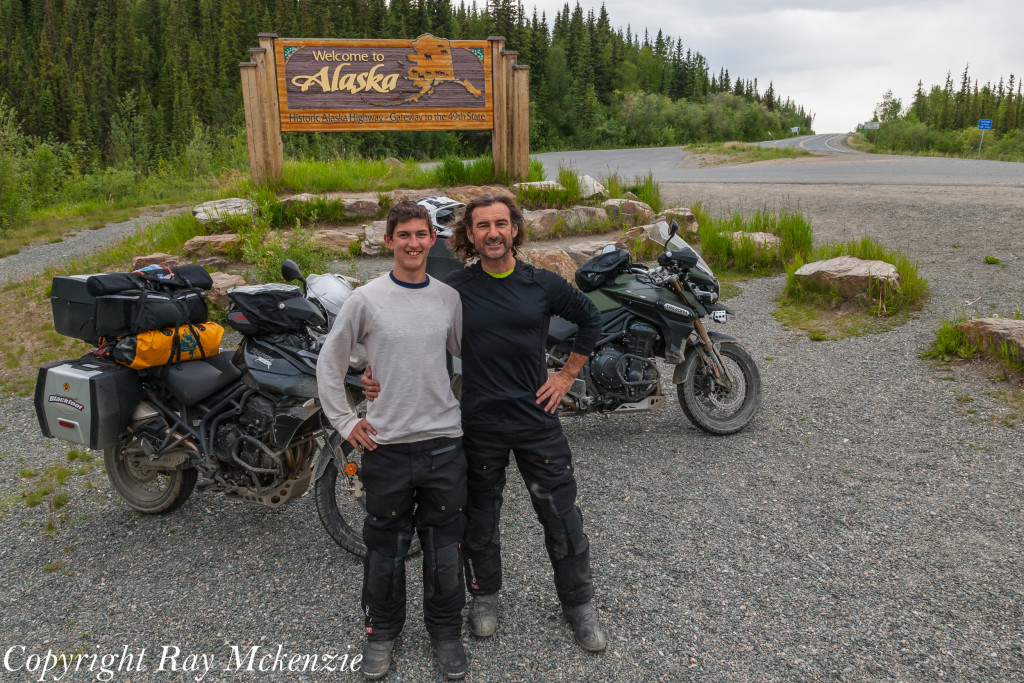 Neale Bayly with Ray Mckenzie Alaska Adventure on Triumph Motorcycles Alaska Sign
